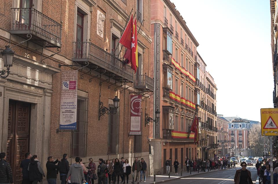 Main Street of Madrid adorned with flags of Spain