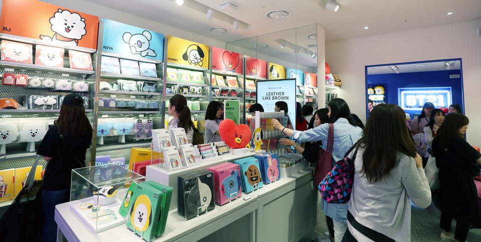 Fans shopping for BTS goods at the Line Friends store