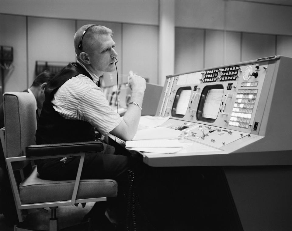 The flight director, is shown at his console