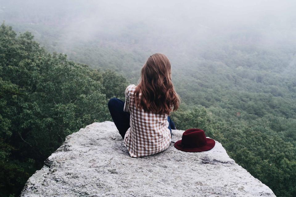 woman hiker hiking on mountain peak