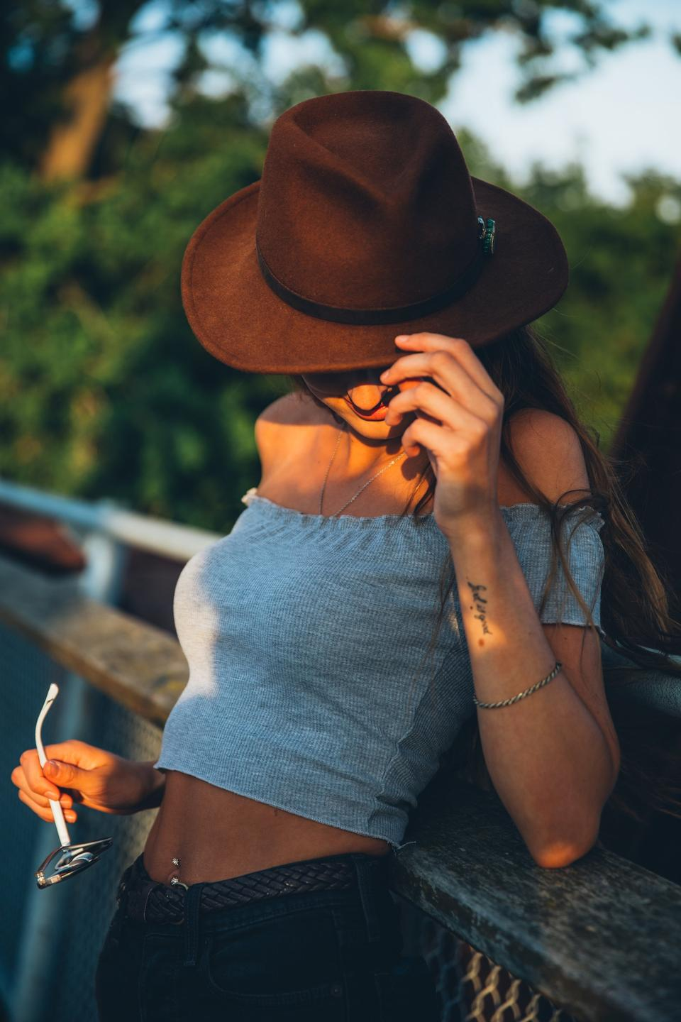 a fashionable woman tips her hat