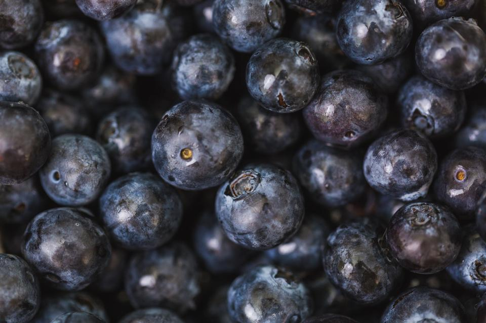 Closeup on blueberries in a full frame pile