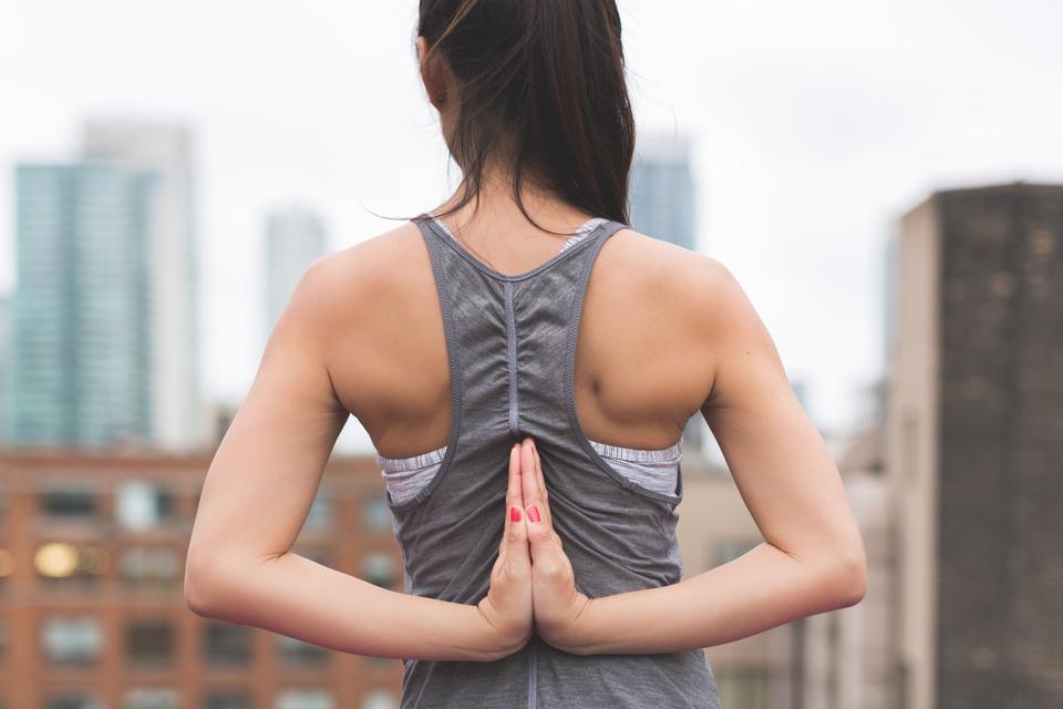 Woman doing yoga prayer pose