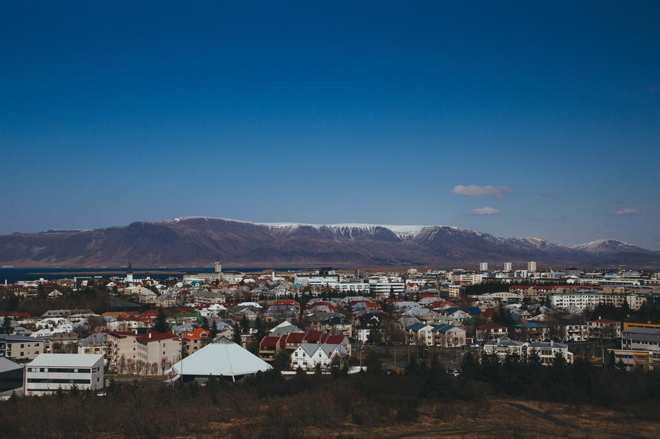 Aerial view of Reykjavik, Iceland with snow capped mountains