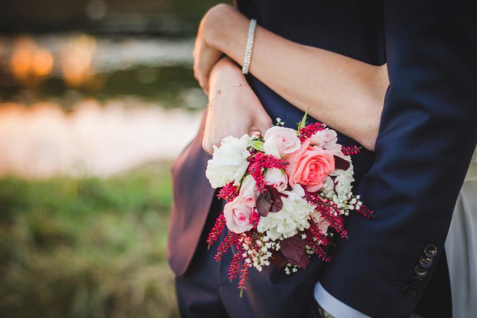 Florist hands with big floral bouquet
