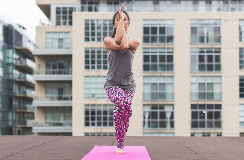 Sporty young woman doing yoga practice