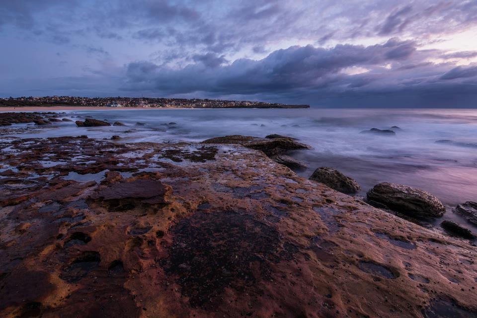 Purple seascape with rock platform
