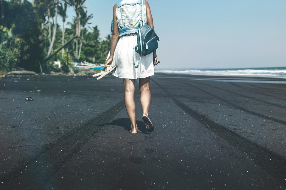 Young woman on a black sand beach