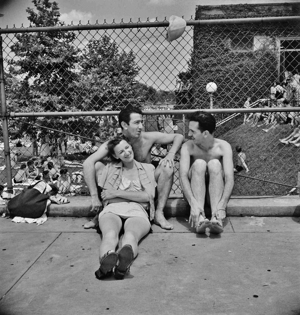 Relaxing on the edge of the municipal swimming pool