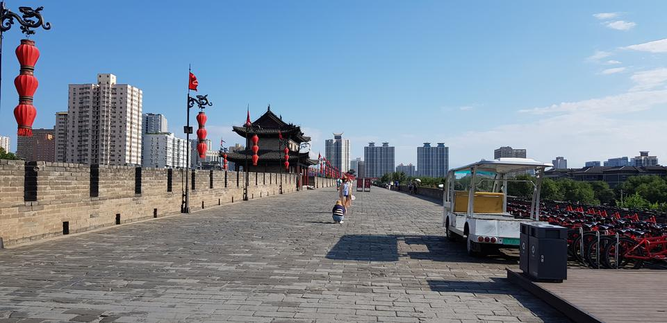beautiful xian city wall and ancient tower at dusk , China