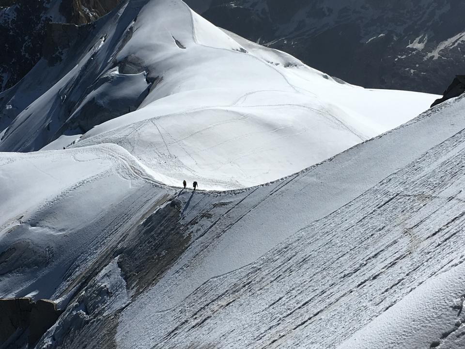 The climbers on the glacier in summer Alps, Chamonix France