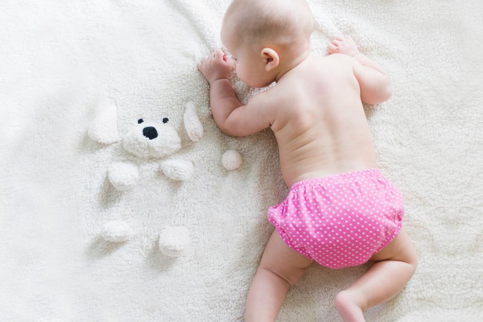 Happy young baby lying on tummy