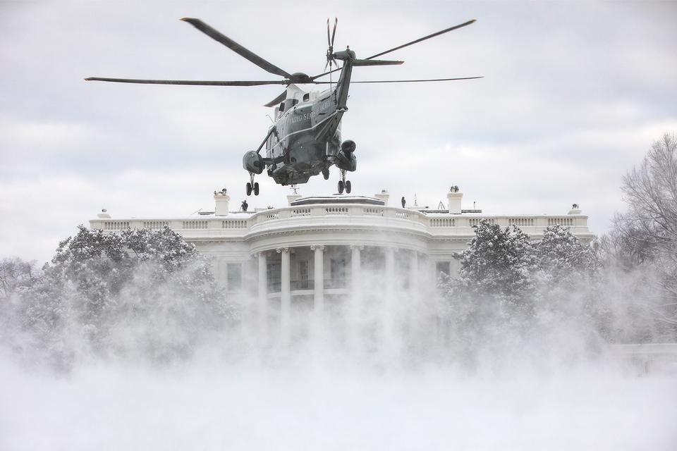Marine One lands on the snow-covered South Lawn