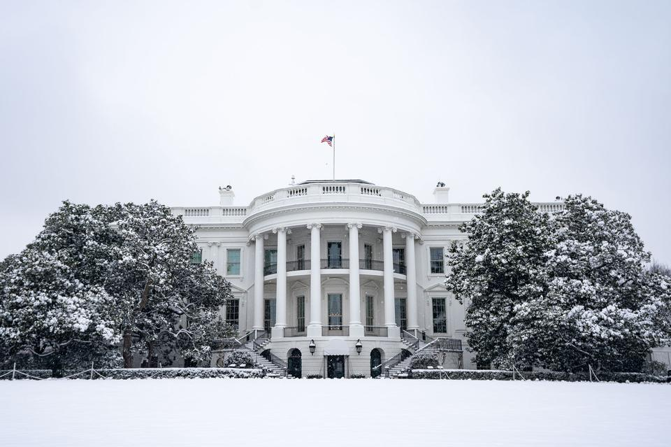 The south side of the White House is seen covered in snow