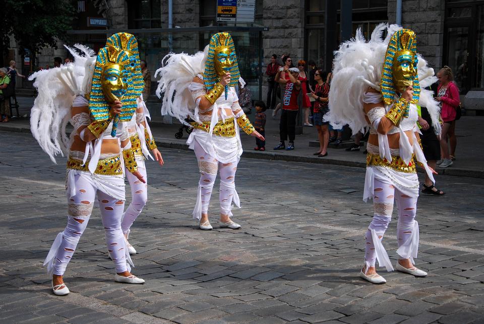 Unknown woman dancing samba on the street