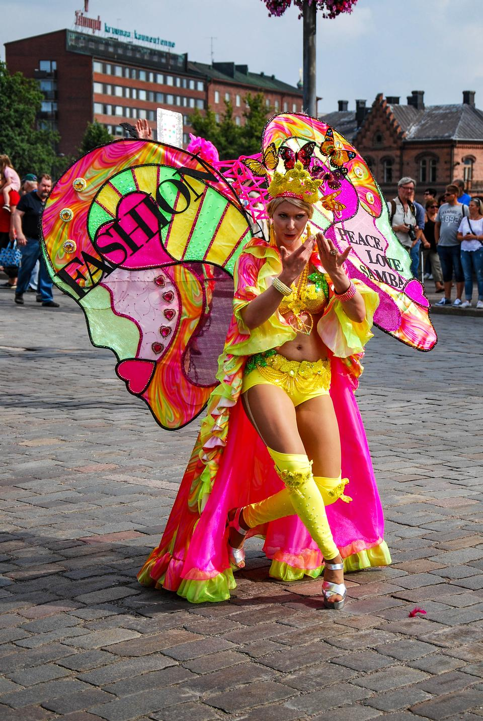 Unknown woman dancing samba on the street