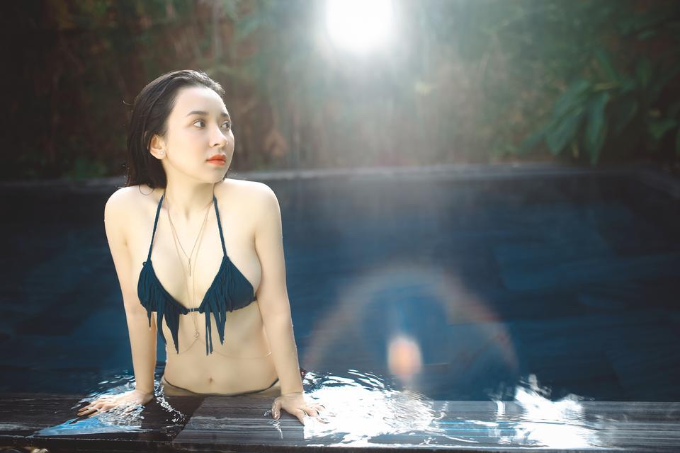 Sexy Asian girl  wearing bikini in the pool