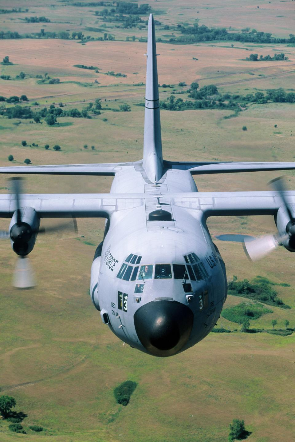 C-130 close up flying clear sky