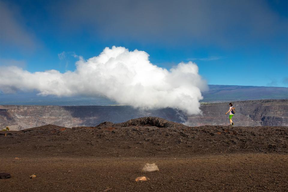 A visitor explores the fissure eruption from Kīlauea volcano