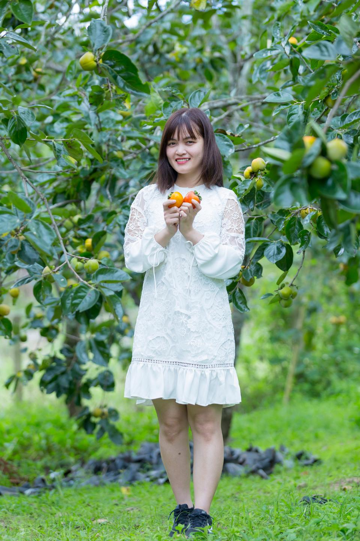 Pretty Asian Girl In wild flowers garden