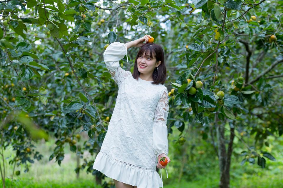 Pretty Asian Girl In wild flowers garden