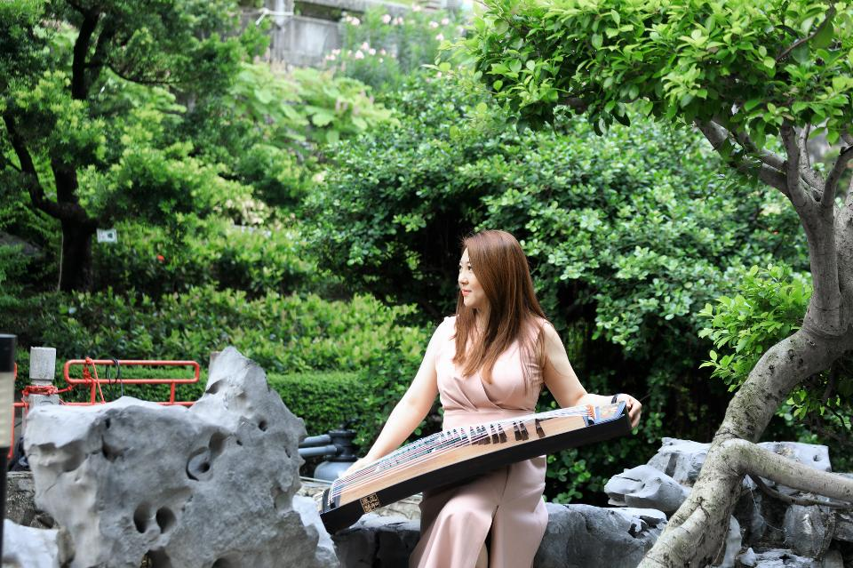 Asian Woman Play traditional Instrument