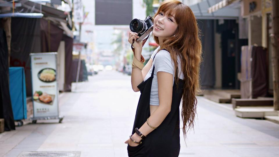 Taiwanese woman with a digital camera