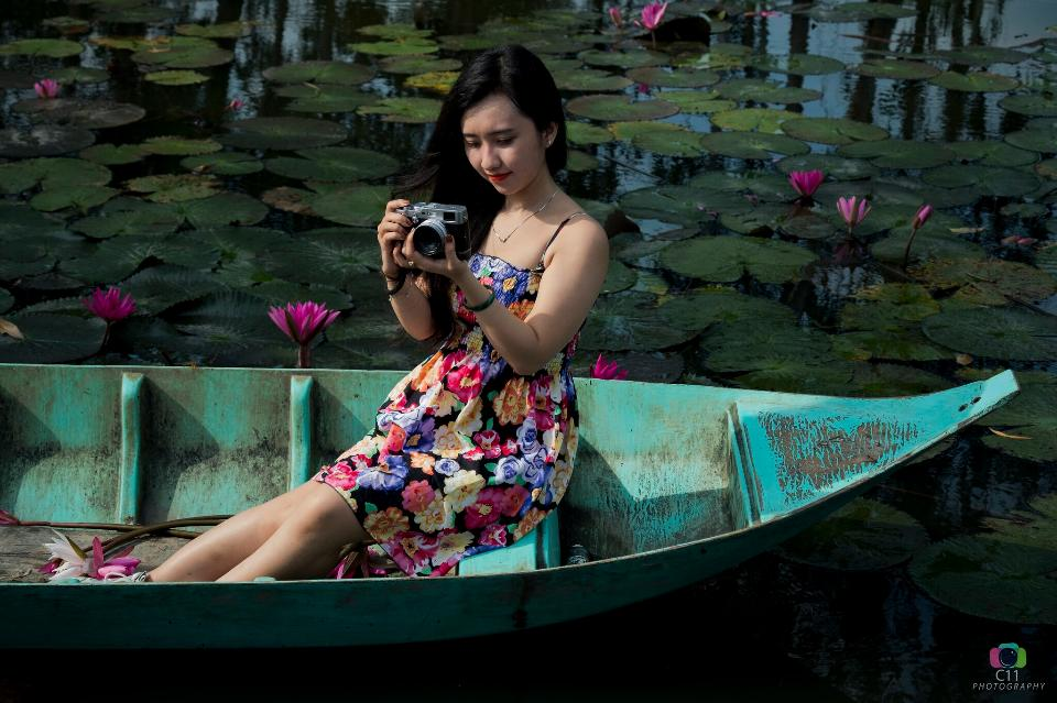 Vietnamese Ladies with digital camera