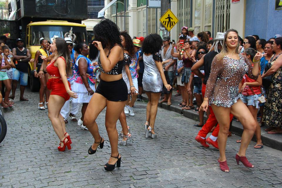 A group of girls in beautiful costumes are dancing at Festival