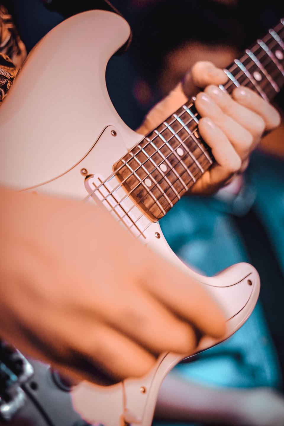 Musicians hands, playing guitar