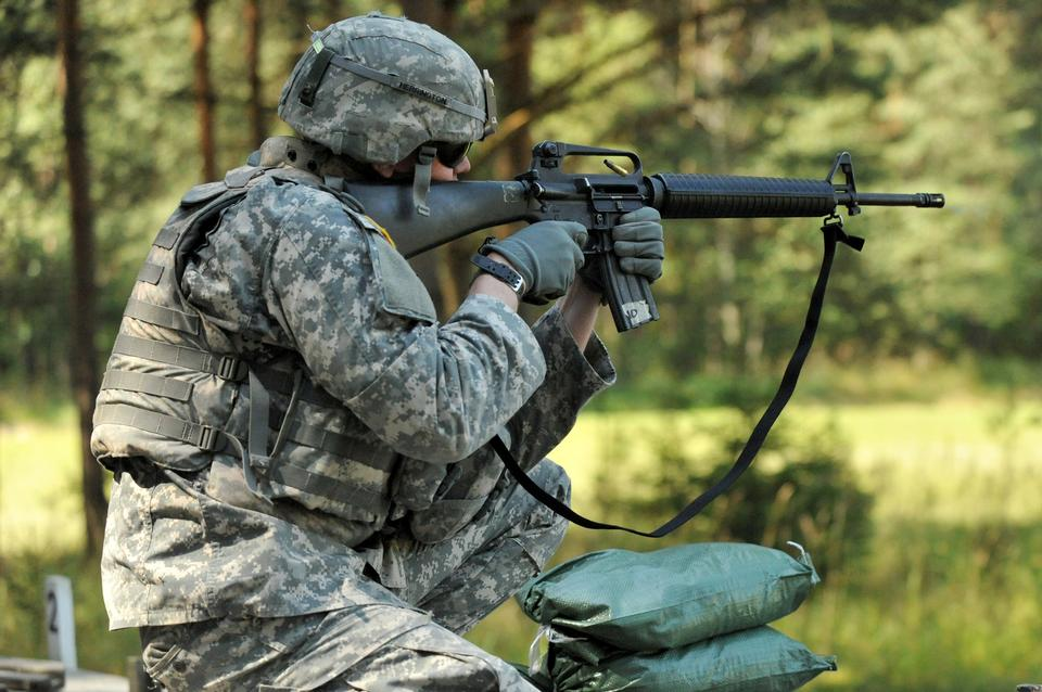 U.S. Army soldier fires his weapon