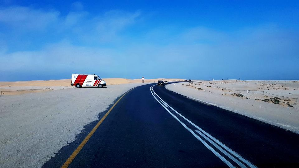 The misty coast road from Swakopmund to Walvis Bay in Namibia