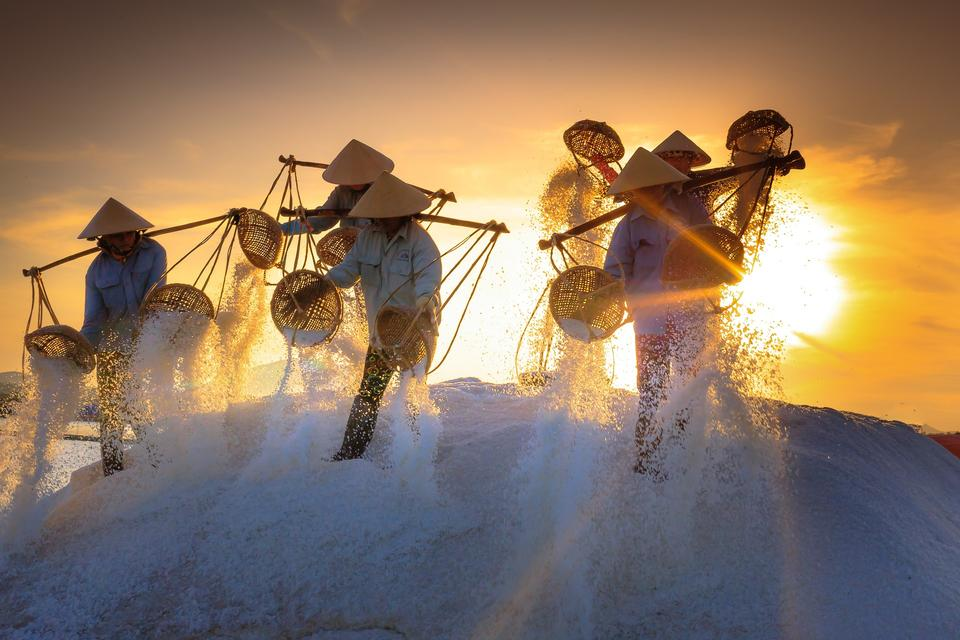 People working on salt field in Nha Trang, Southern Vietnam