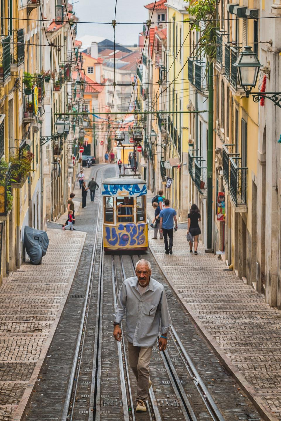 Romantic Lisbon street with the typical yellow tram