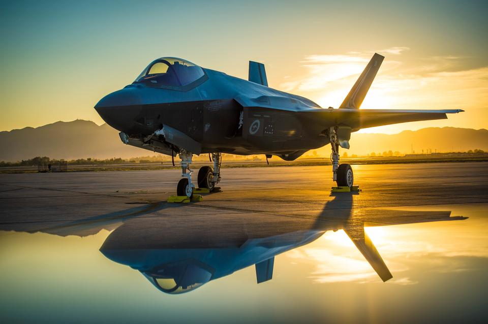 The sun sets behind an Australian F-35A Lighting II aircraft