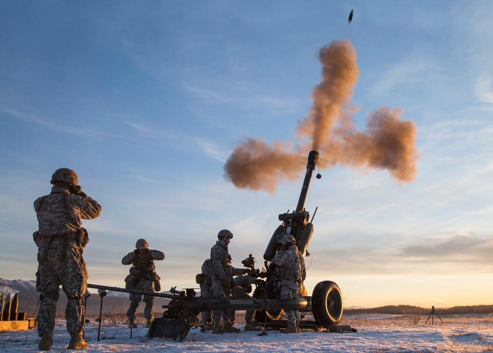 Combat Team fire a 105 mm howitzer