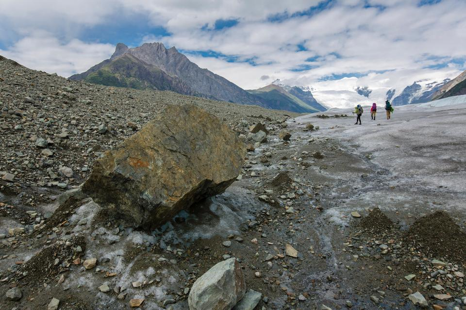 Backpackers Exploring the Root Glacier