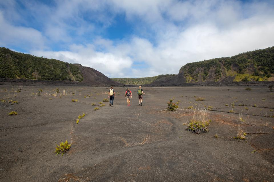 Hikers on Kīlauea Iki Trail
