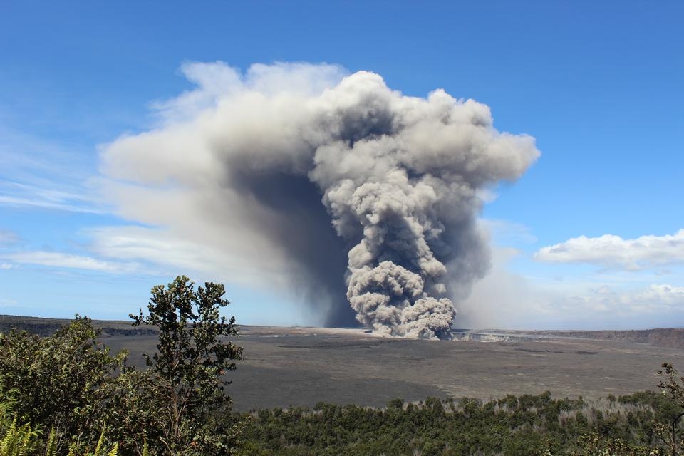 A large plume of volcanic ash and debris wafts