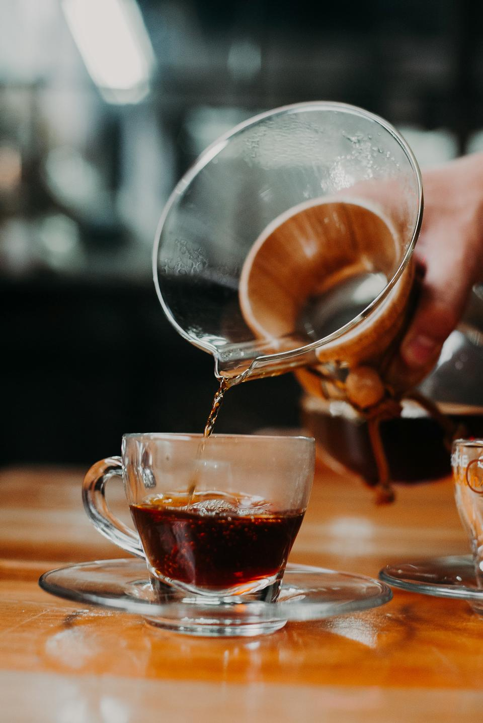 Close-up view of bartender preparing coffee