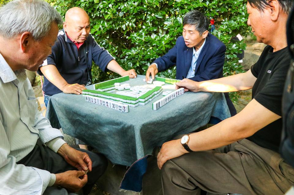 Playing Mahjong on table