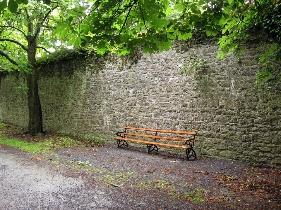Bench against a brick wall; urban scenery