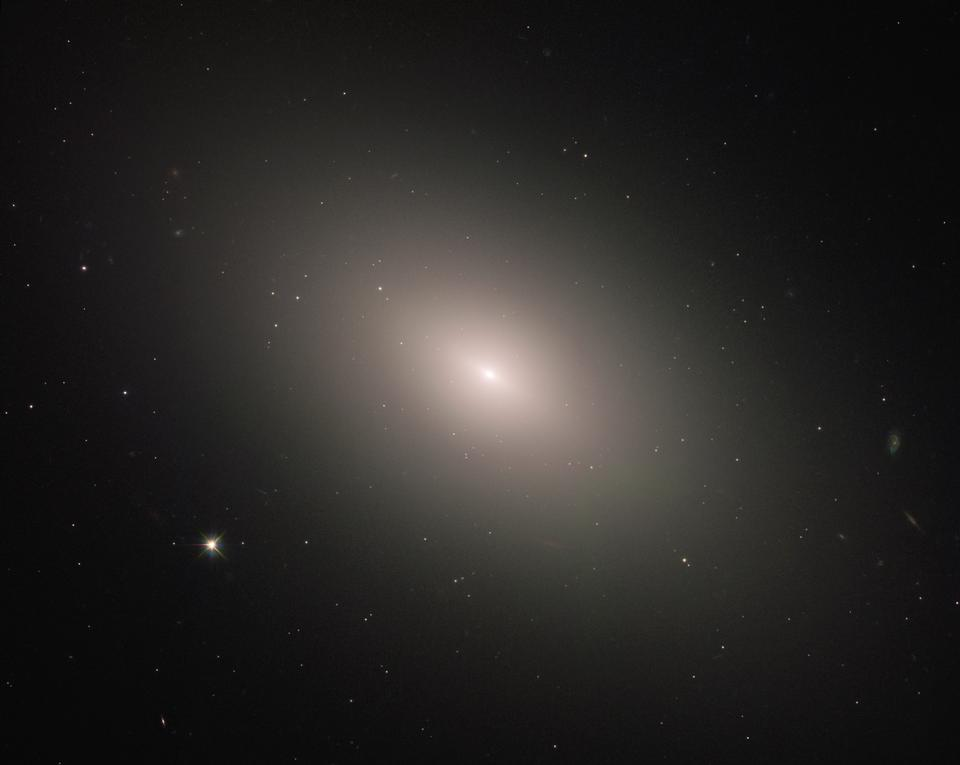 This luminous orb is the galaxy NGC 4621
