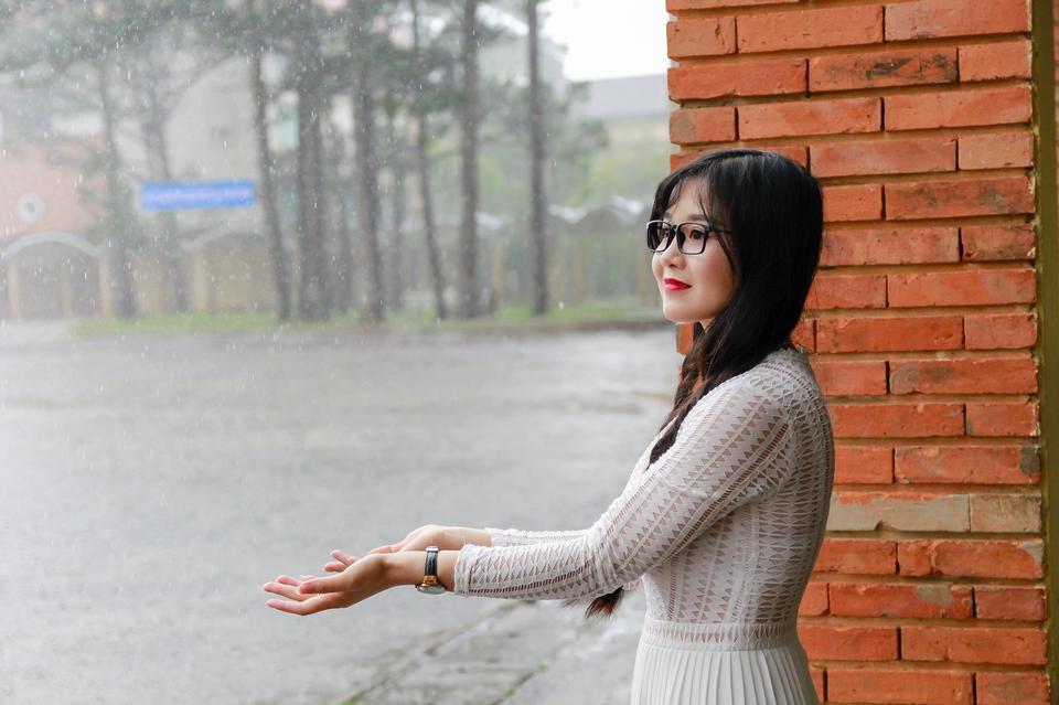 Japanese Woman standing under the rain