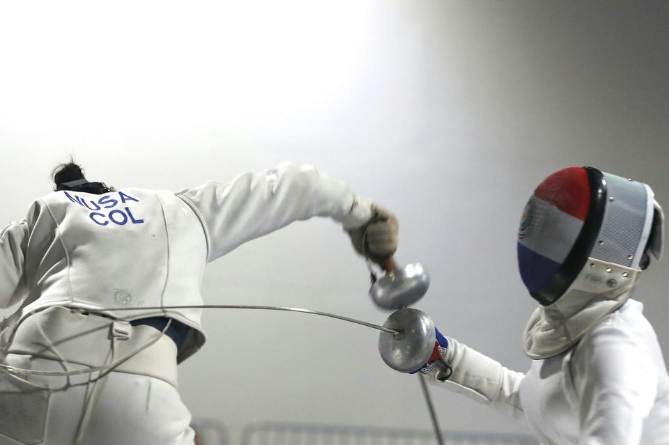 Two Woman fencing athletes fight on professional sports