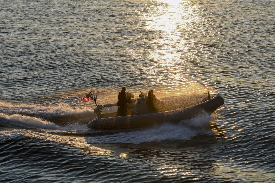 Sailors perform small boat operations