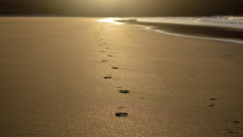 Footprints of human feet on the sand