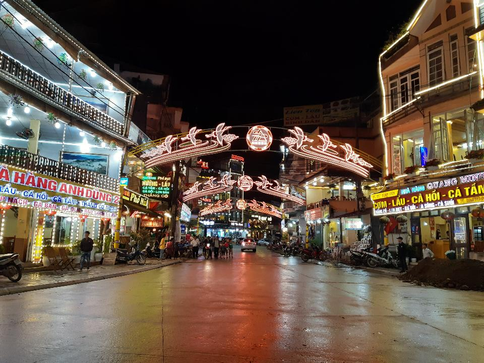 Tourist enjoying nightlife in downtown of Sapa