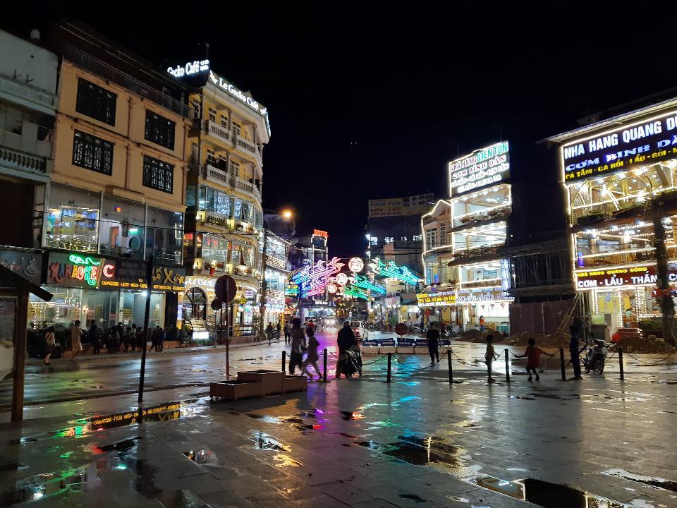 Tourist enjoying nightlife in downtown of Sapa