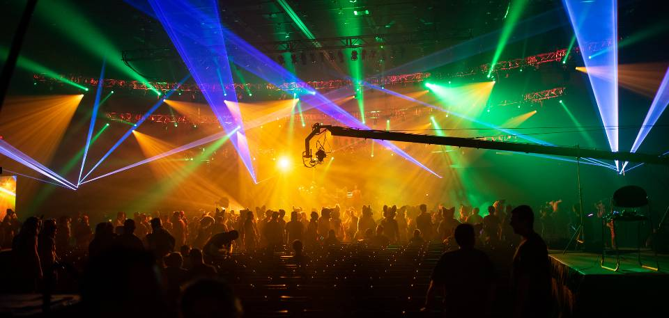 dj night club party rave with crowd in music festival
